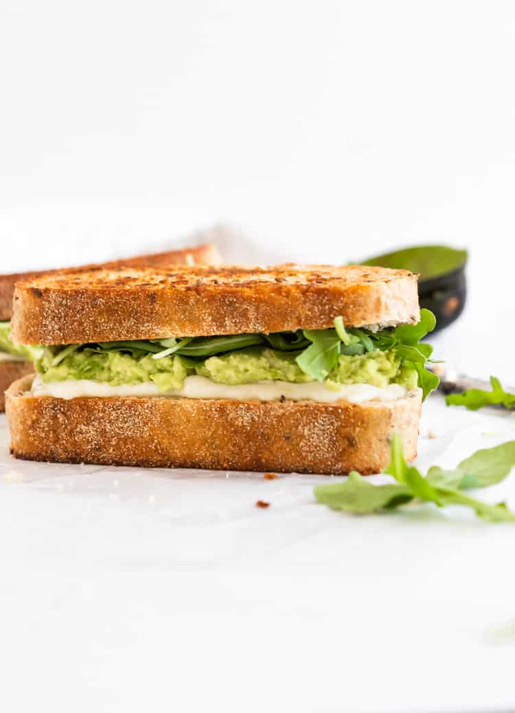Grilled cheese sandwich with Havarti, avocado and baby arugula.