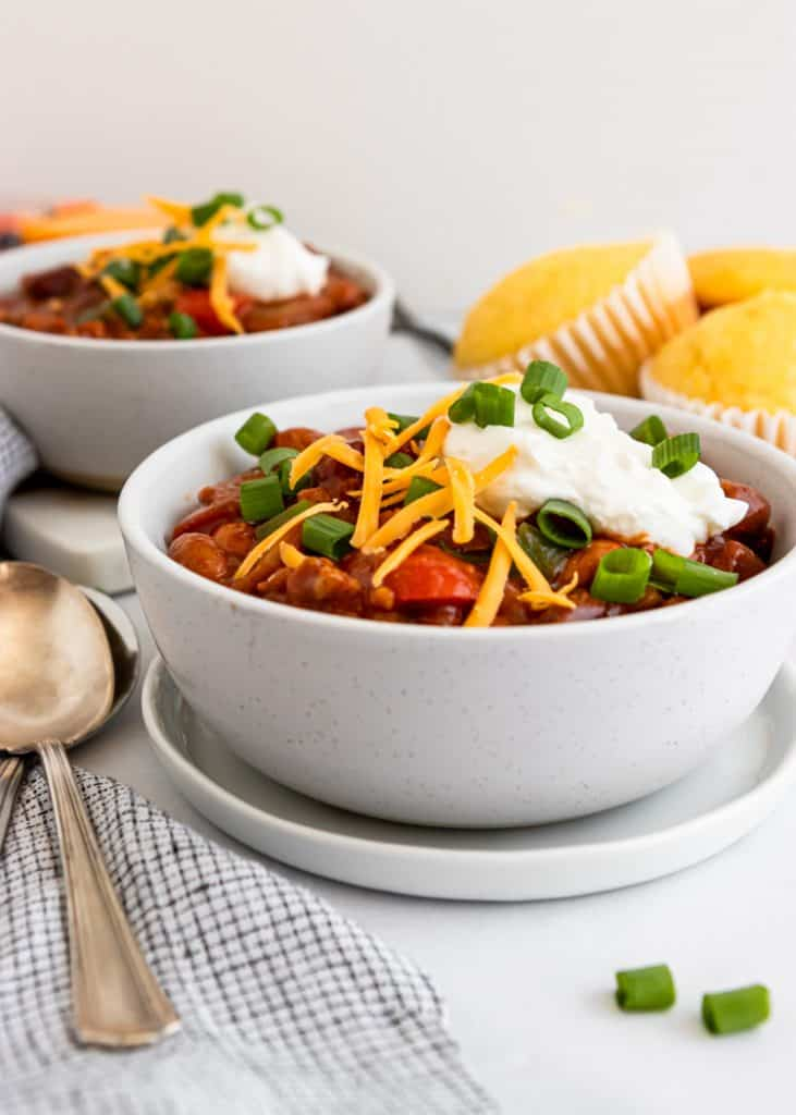 Bowl of turkey chili with toppings.