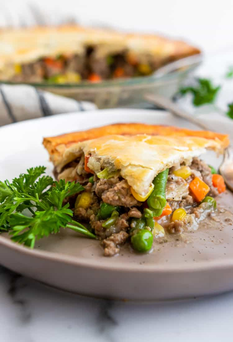 Beef Pot Pie on plate with parsley