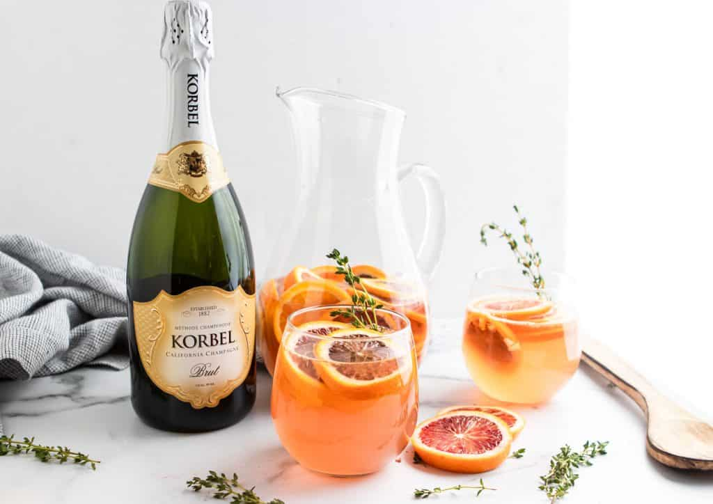 Korbel Champagne with Blood Orange Sangria pitcher and glasses.