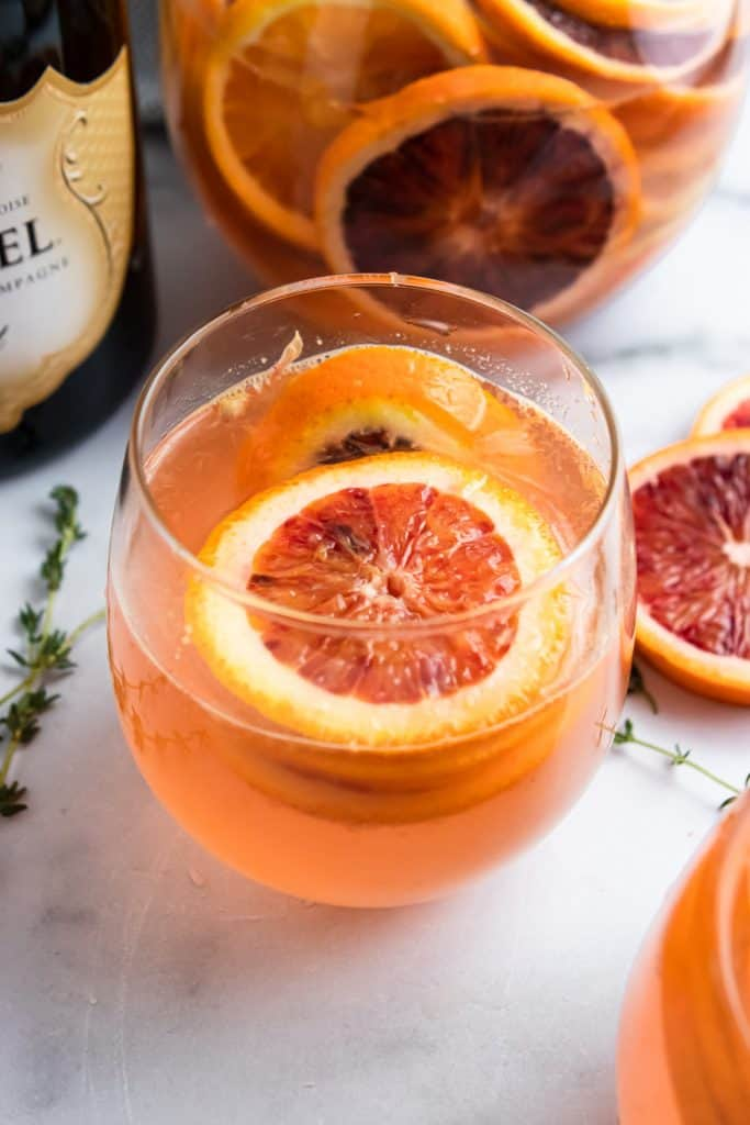Glass of Blood Orange Champagne Sangria.