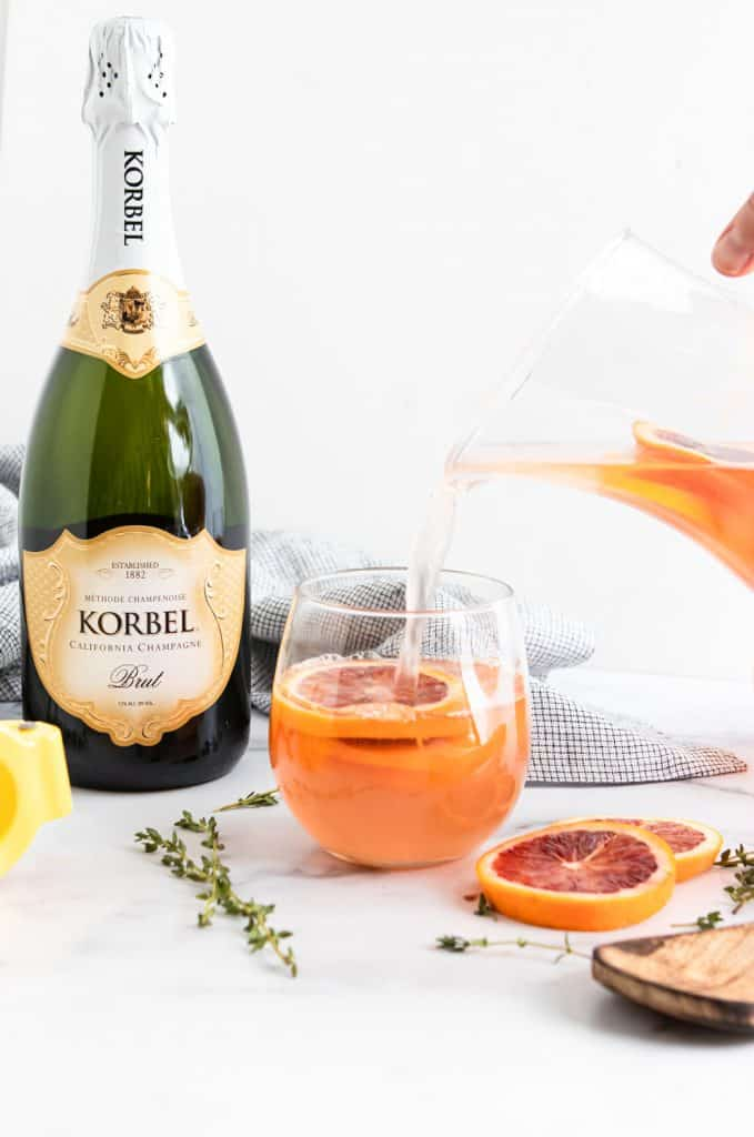 Blood Orange Champagne Sangria poured into glass.