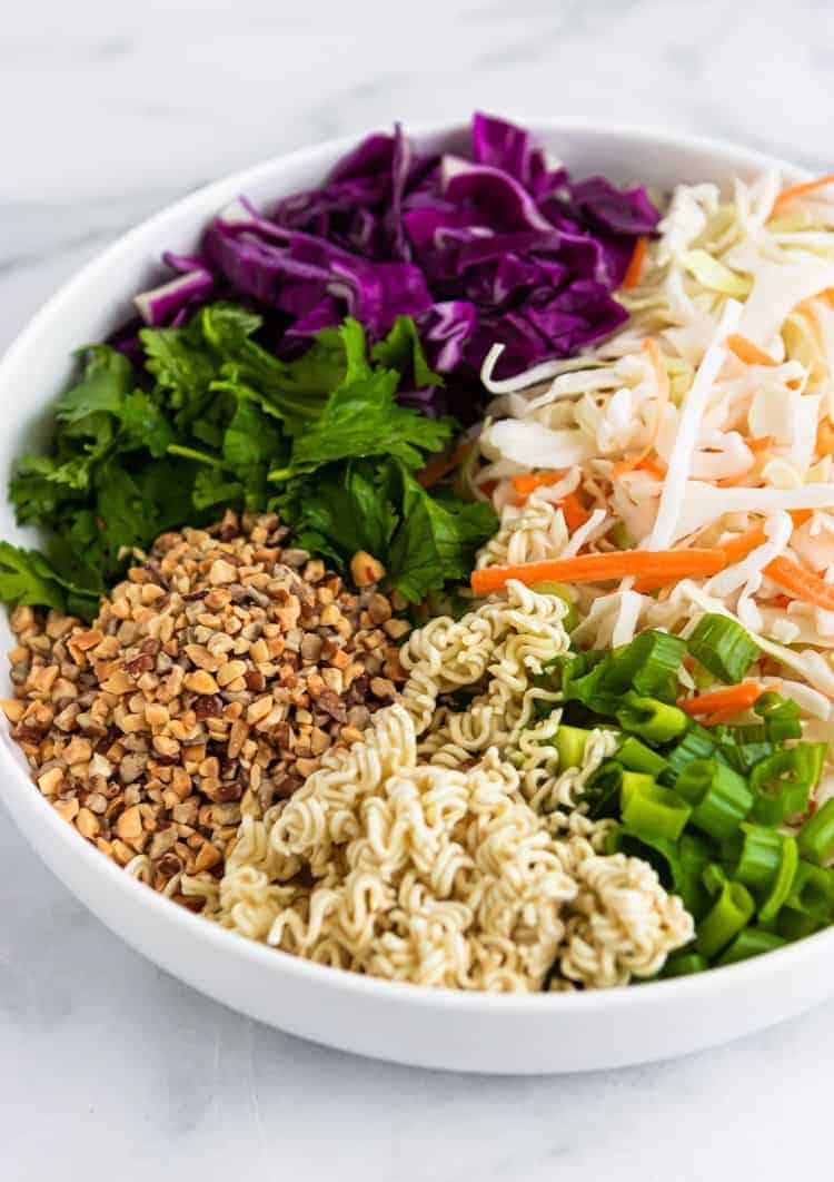 Ingredients for Ramen Cabbage Salad in white bowl.