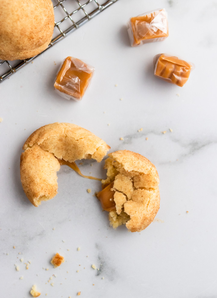 Overhead shot of Caramel Filled Snickerdoodle Cookie and caramels.