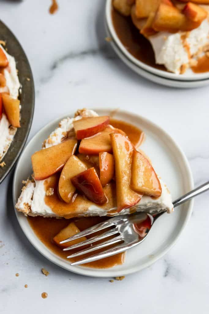 Slice of Caramel Apple Cheesecake with fork.