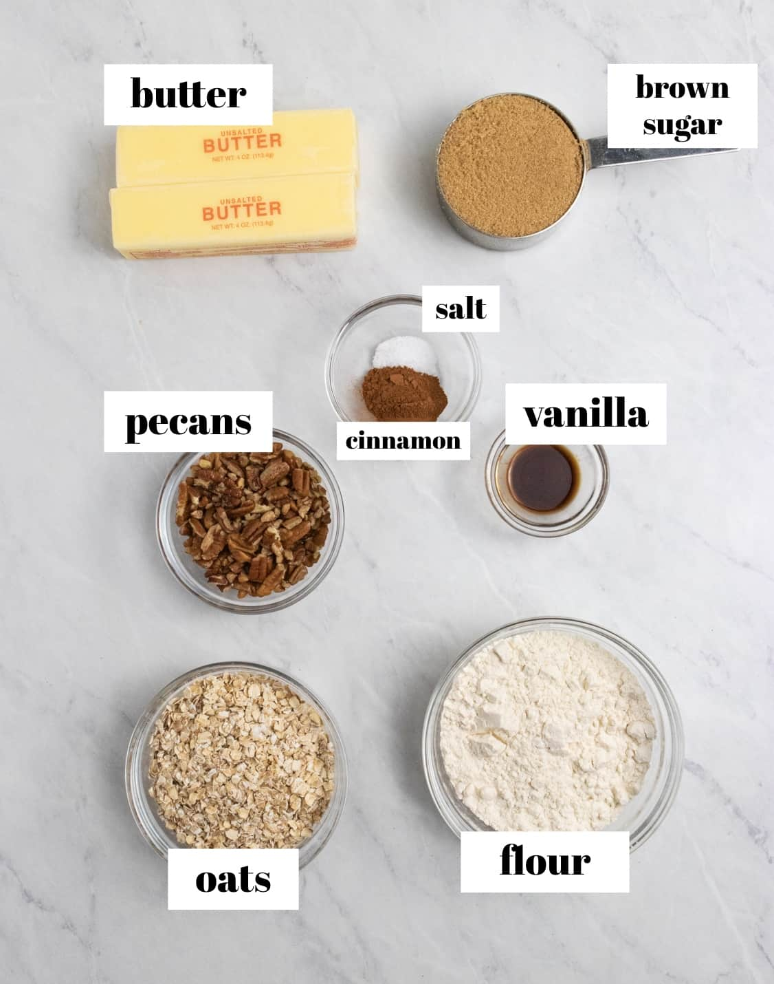 Oats, brown sugar, butter and other ingredients labeled on counter.