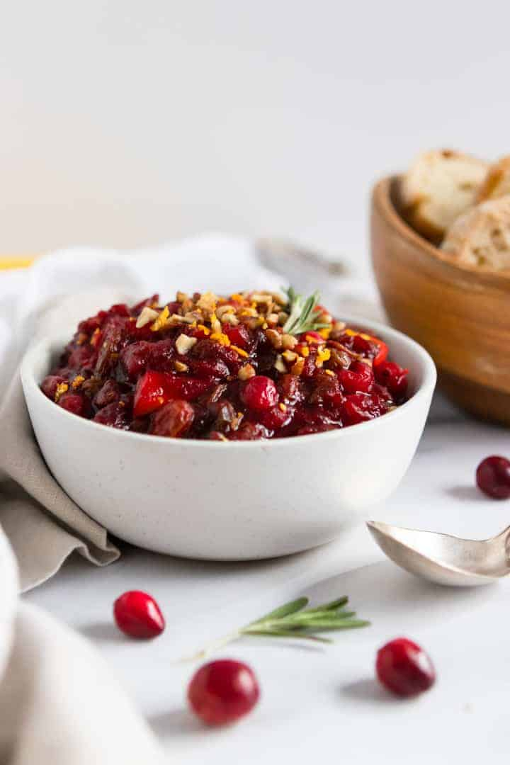 Balsamic Cranberry Chutney recipe with bread bowl and spoon.