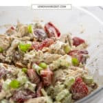 Mixing bowl with strawberry chicken salad.