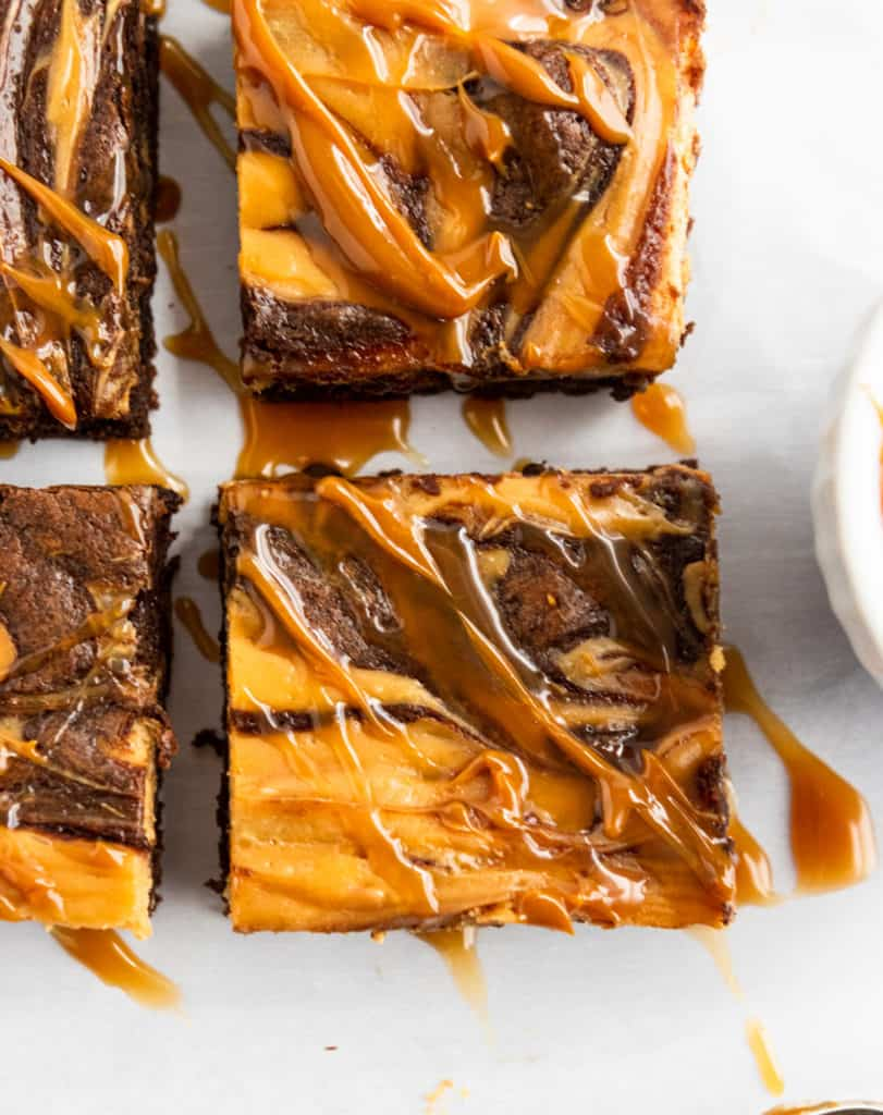 Close up of Cheesecake swirl brownies with dulce de leche drizzle
