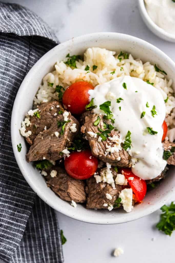 Rice bowl with Mediterranean steak bites and yogurt sauce.