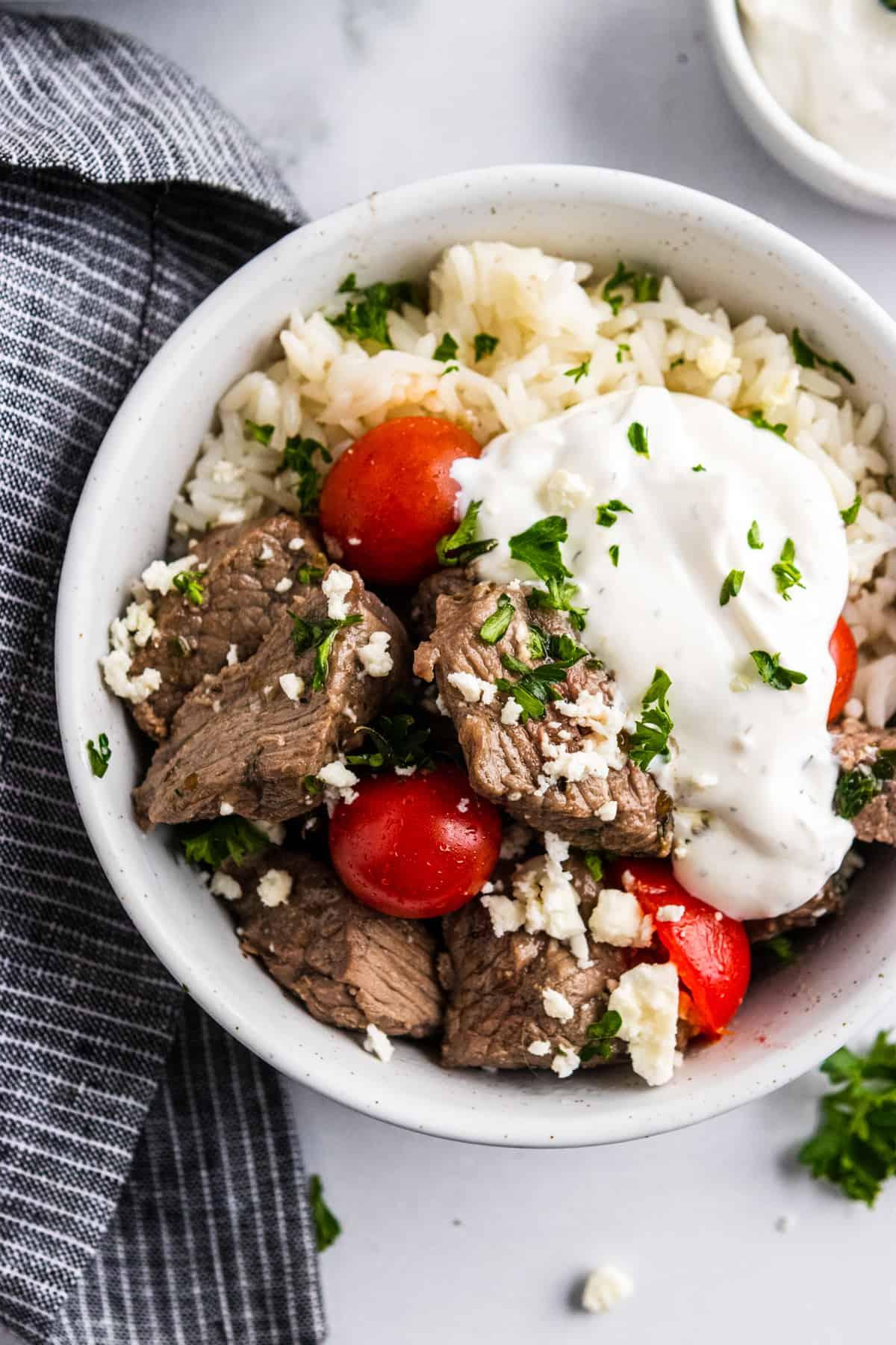 Rice bowl with Mediterranean steak bites and yogurt sauce.