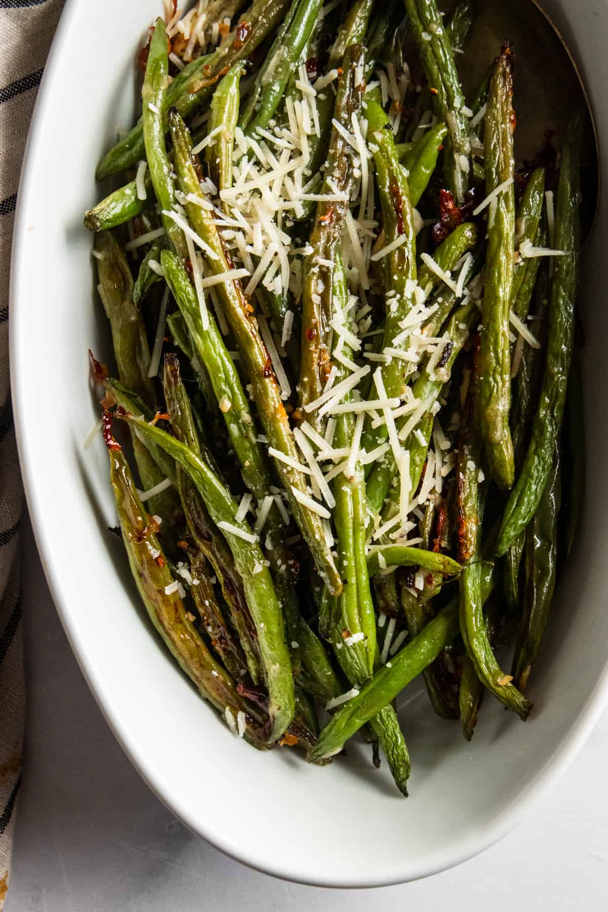 Roasted green beans in serving bowl.