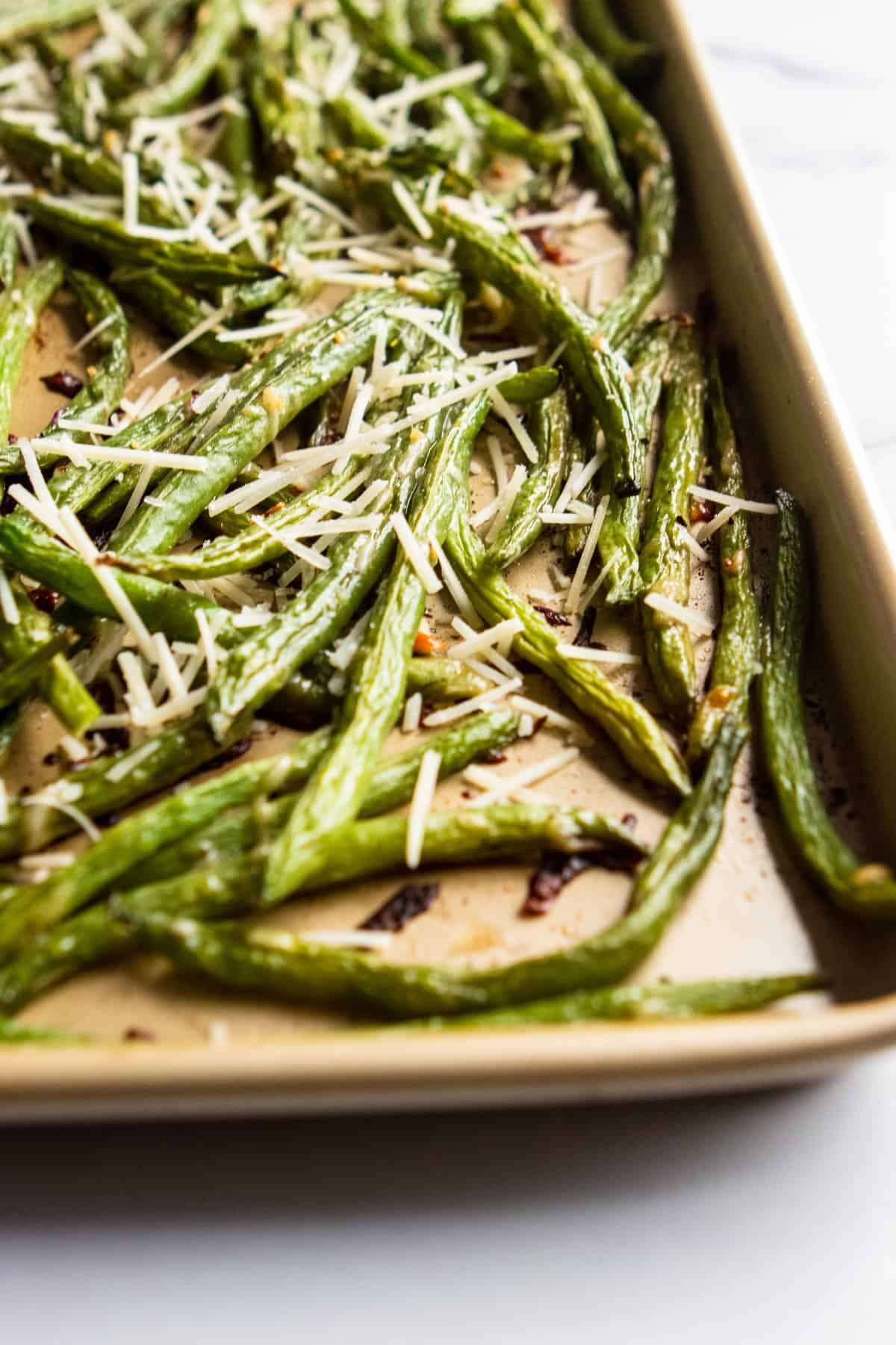 Baking sheet with roasted parmesan green beans.