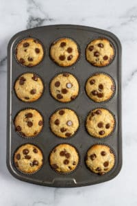 Freshly baked muffins from the oven in tin.