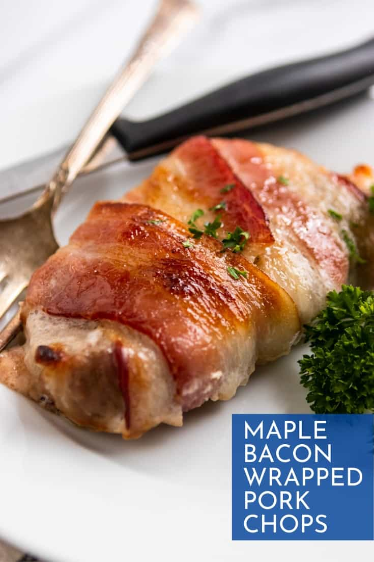 Pork chop wrapped in bacon on plate with fork and knife.