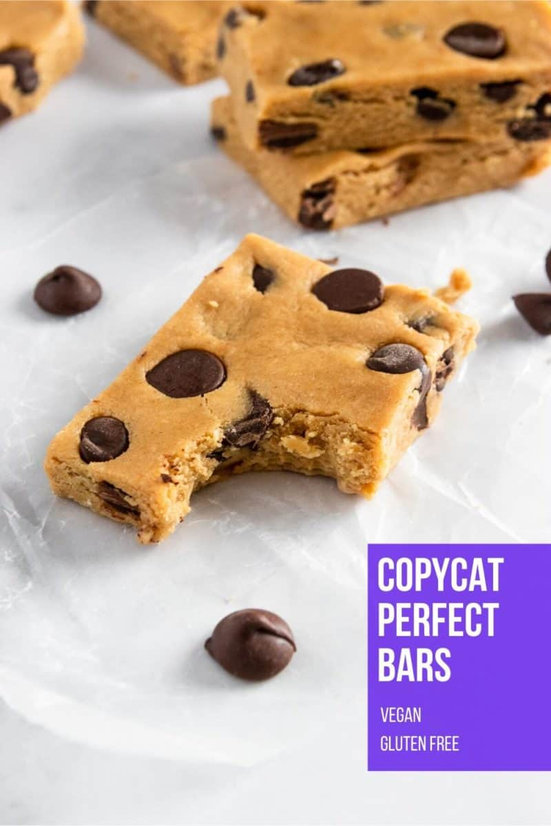 Peanut butter chocolate chip protein bar with bite out.