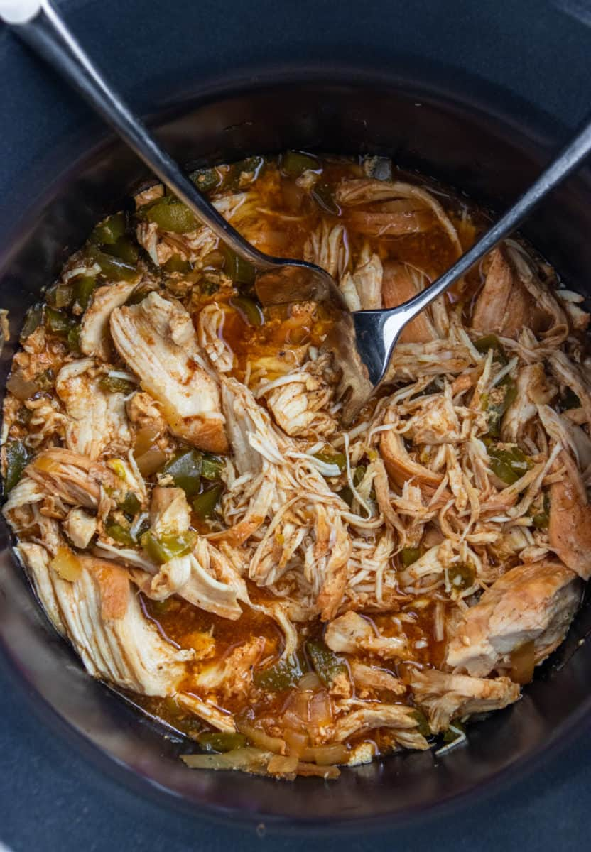 Shredded chicken in slow cooker.