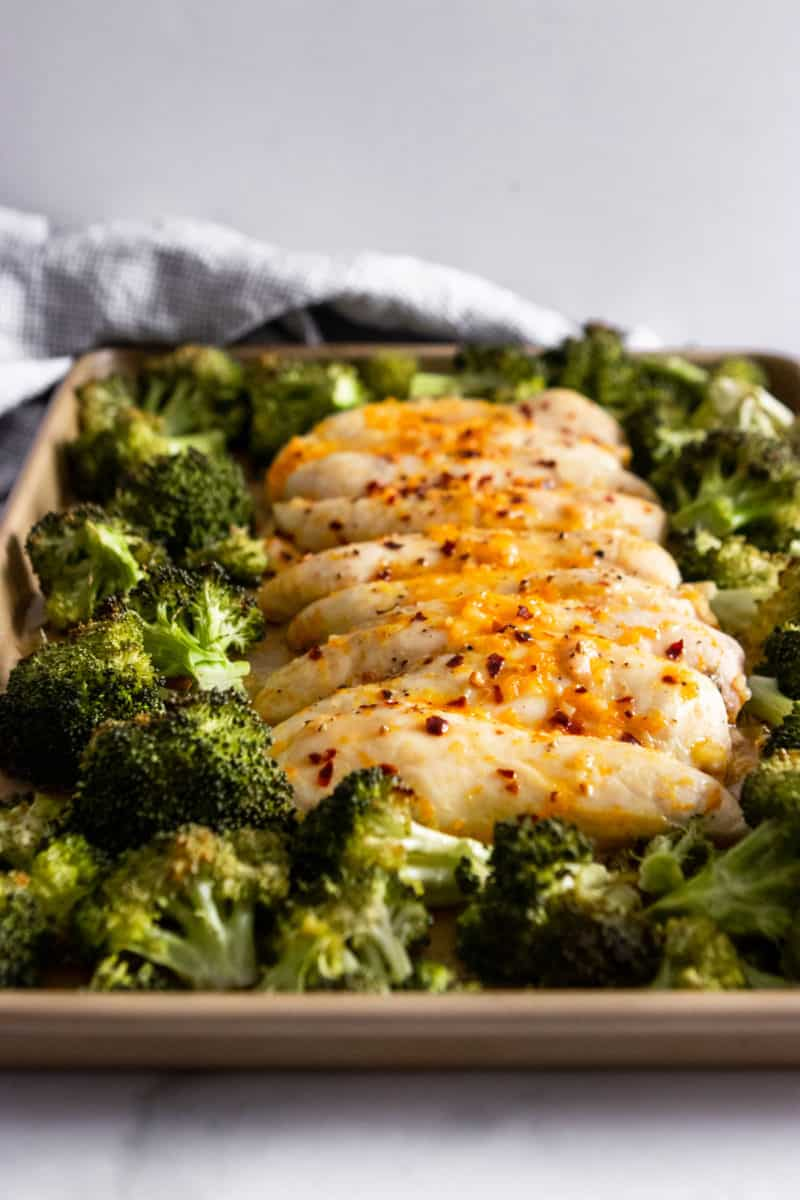 Chicken and broccoli on sheet pan.