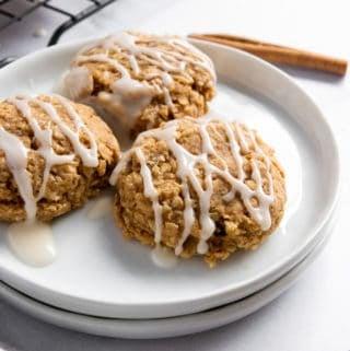 Cinnamon Roll Breakfast Cookies on white plate.