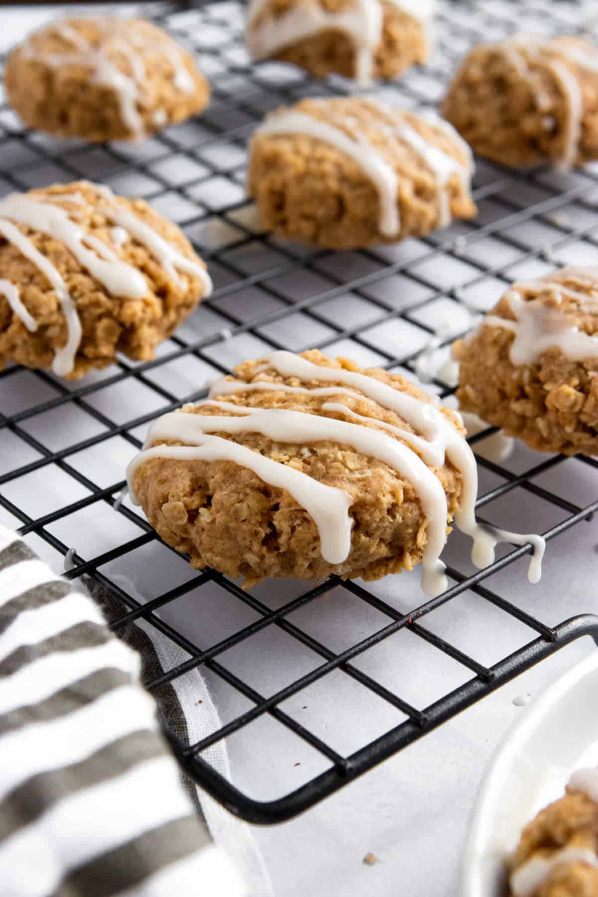 Breakfast Cookies with icing drizzle on cooling rack.