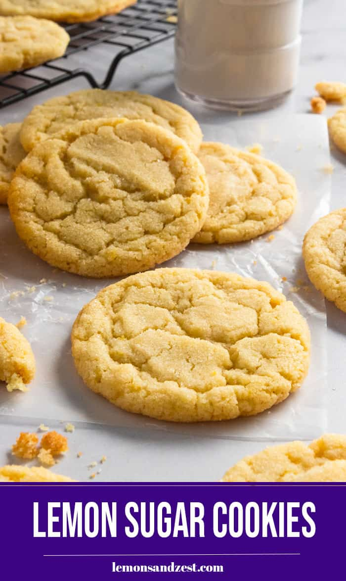 Sugar cookies on parchment with milk.
