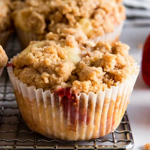 Strawberry Muffin with crumble topping on cooling rack.
