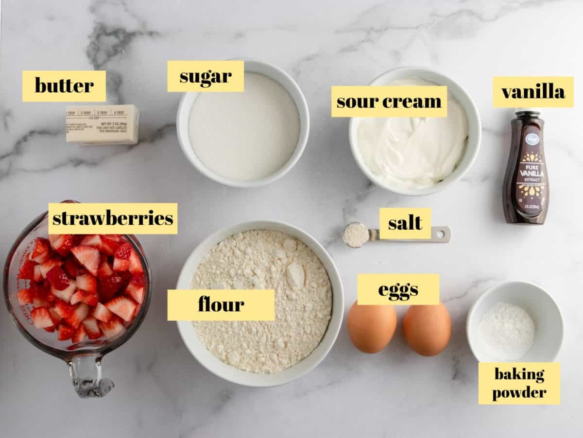 Ingredients to make strawberry muffins.