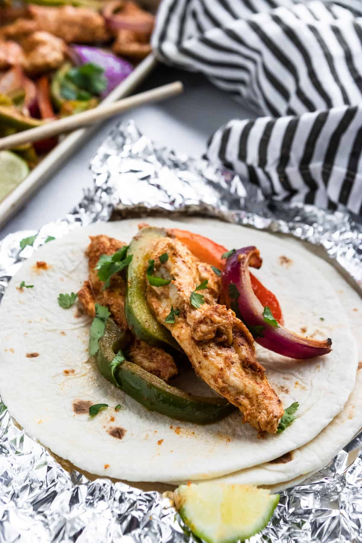 Honey Lime Baked Chicken Fajitas on foil.