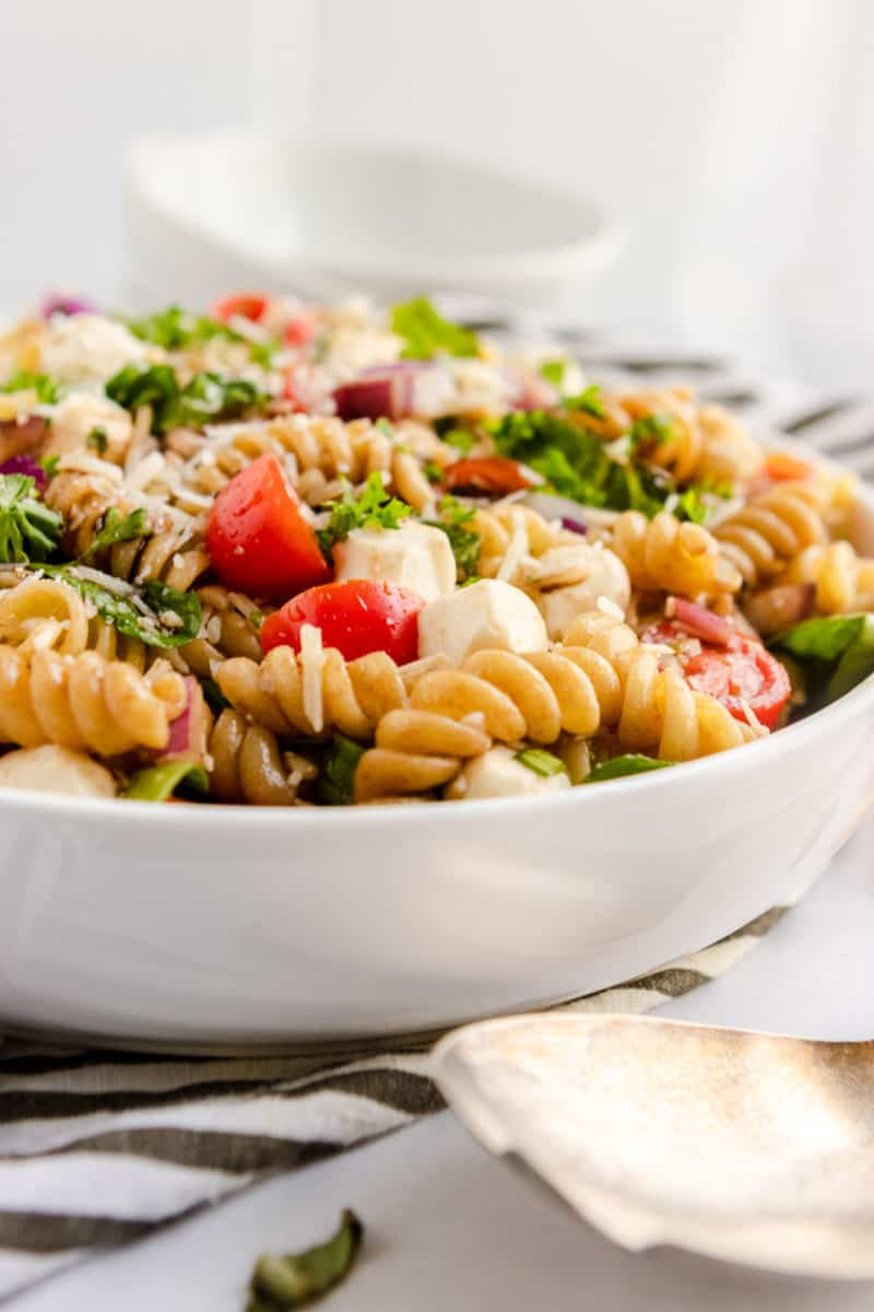 Tomato basil pasta salad in bowl.