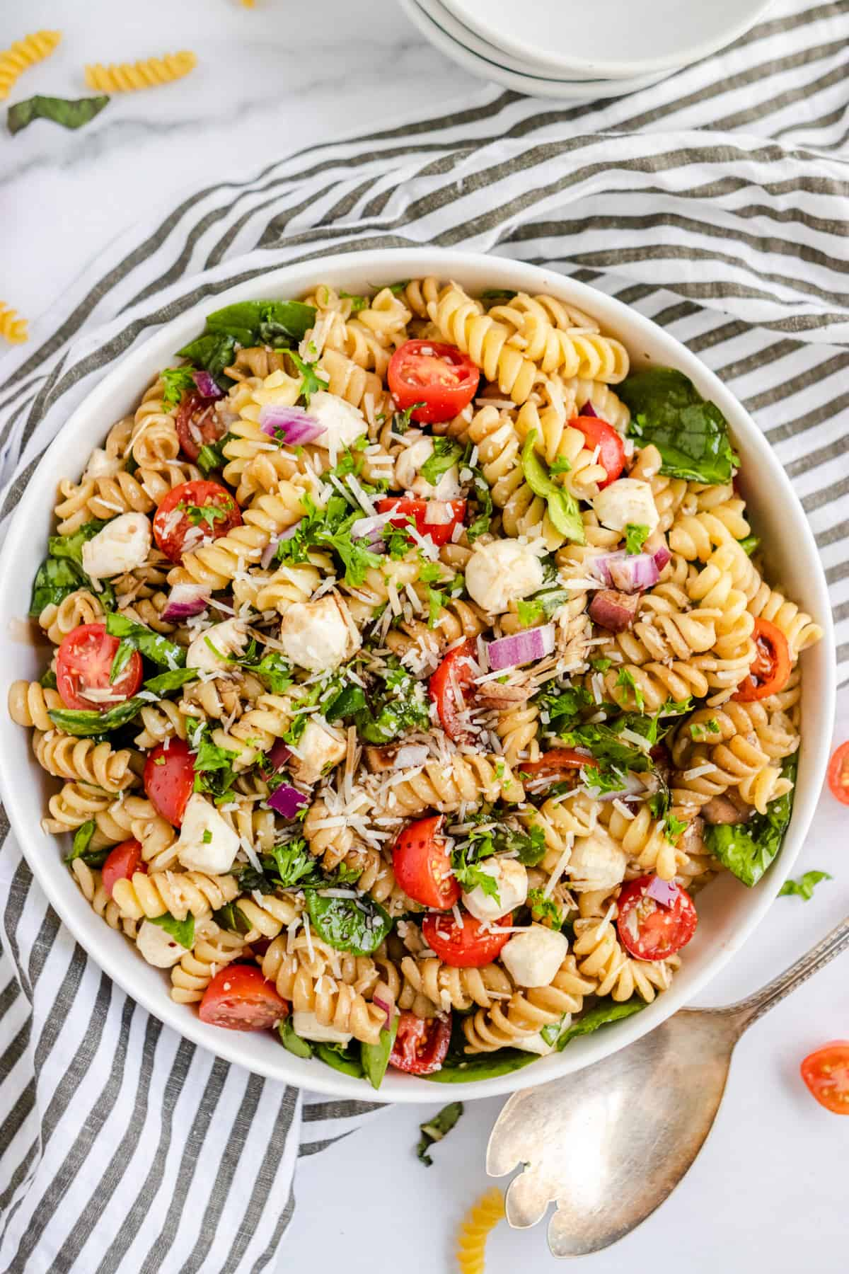 Overhead shot of rotini pasta salad with serving spoon.
