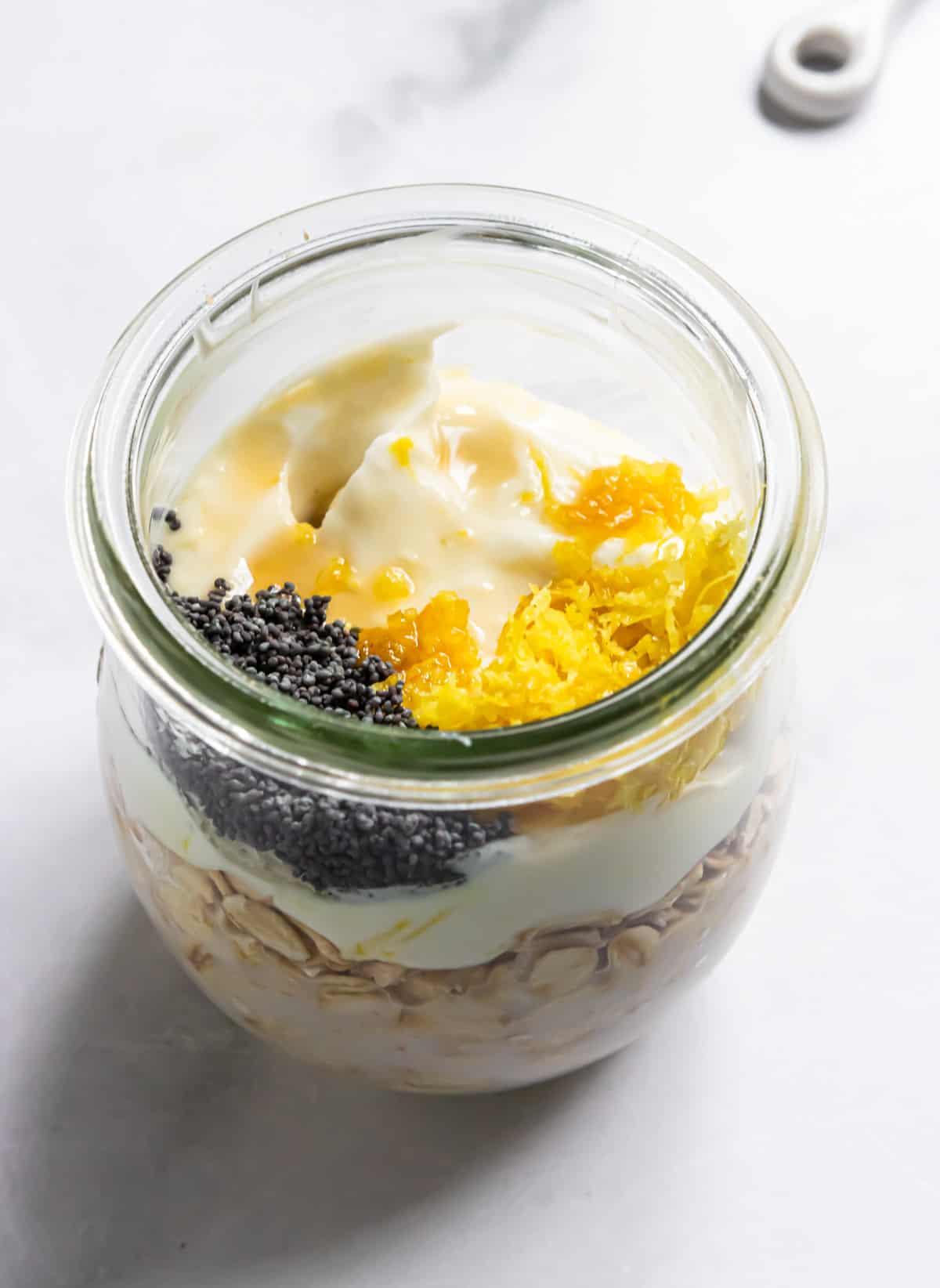 Ingredients to make oatmeal recipe in jar.