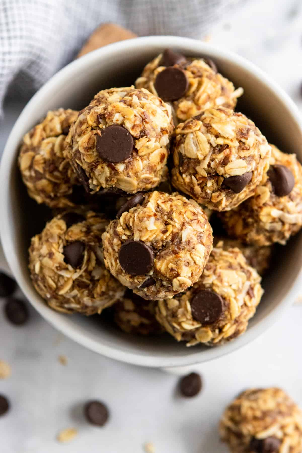 Peanut butter oatmeal balls with chocolate chips in bowl.