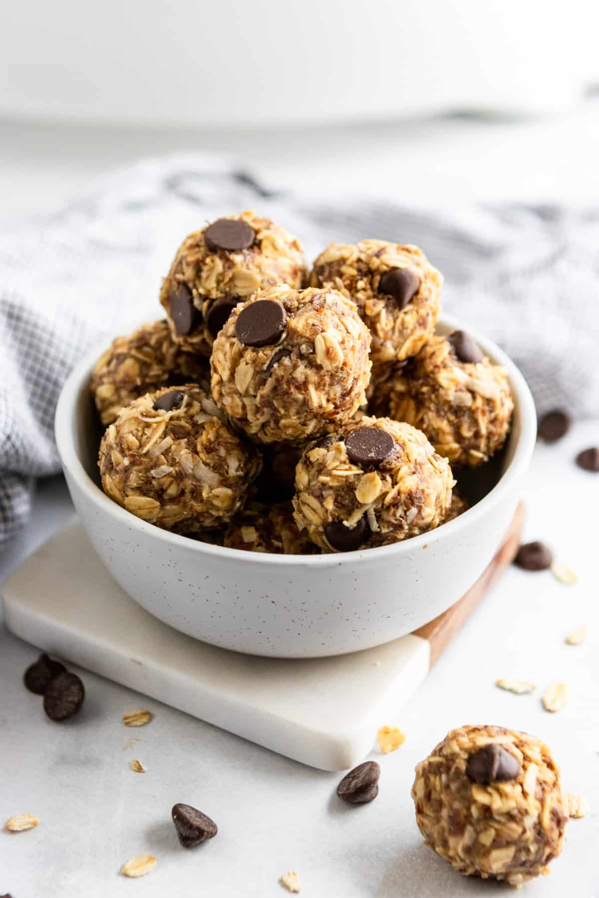Peanut Butter Oatmeal balls in bowl on coaster.