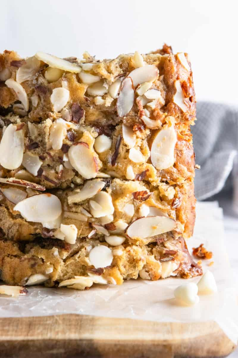 Stack of sliced banana bread with almonds.