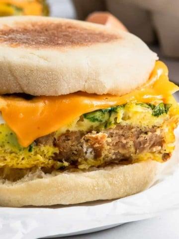 Sausage spinach egg mcmuffin sandwich.