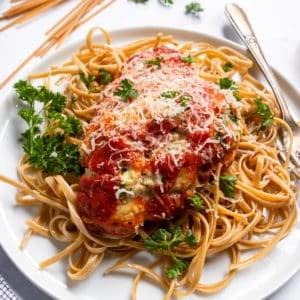 Spinach ricotta chicken on pasta.