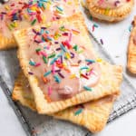 Pop tarts with sprinkles stacked.