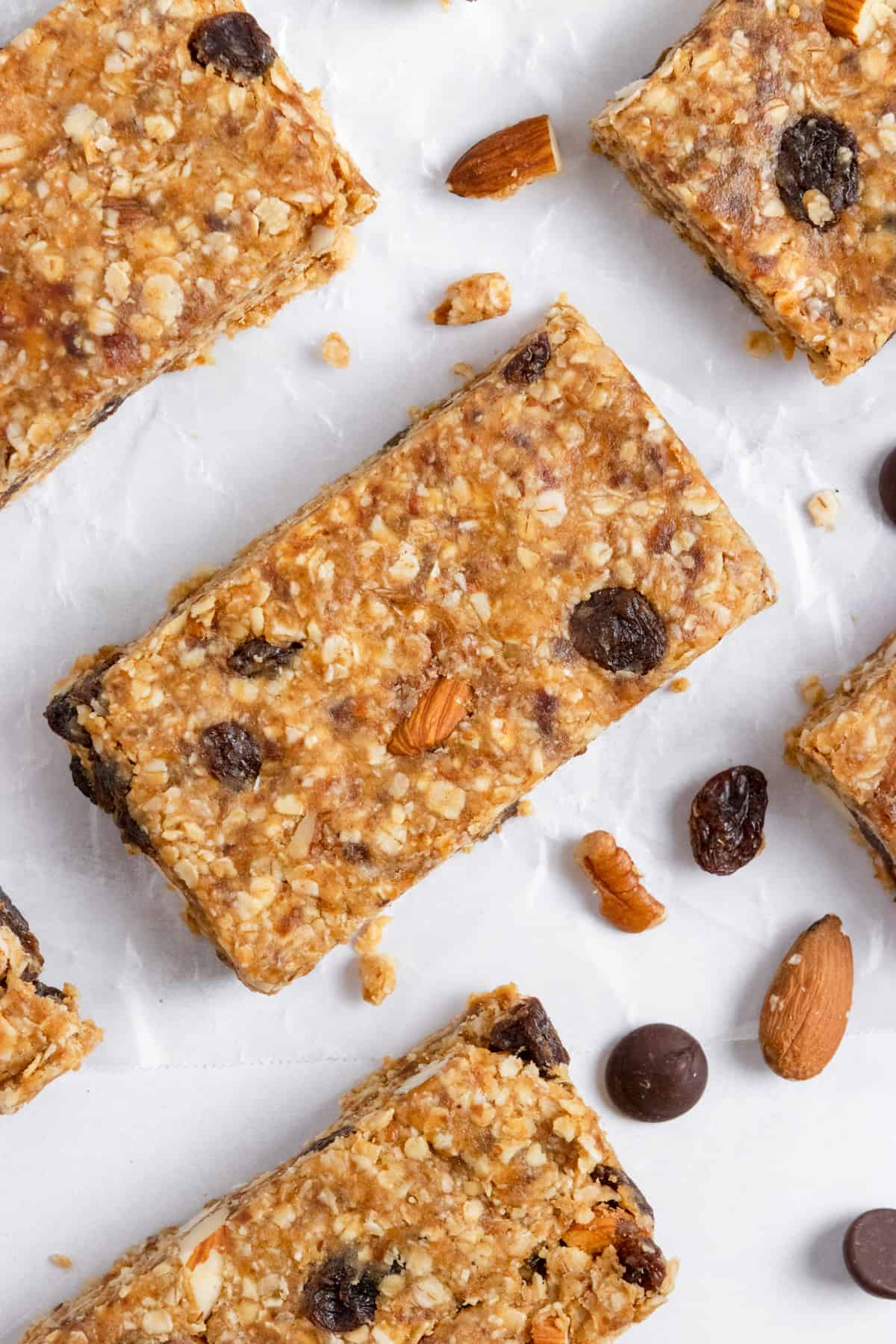 Trail mix bars laying on wax paper.