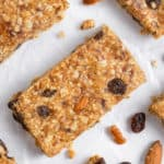 No bake trail mix bars with raisins and nuts on parchment.