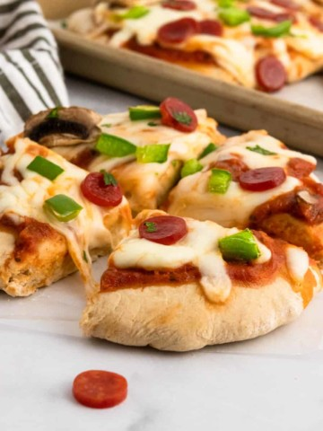 Whole wheat pizza dough baked with toppings.