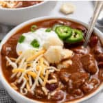 Chili in bowl with spoon.