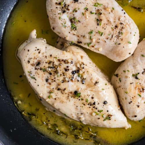 Pan seared chicken in skillet.