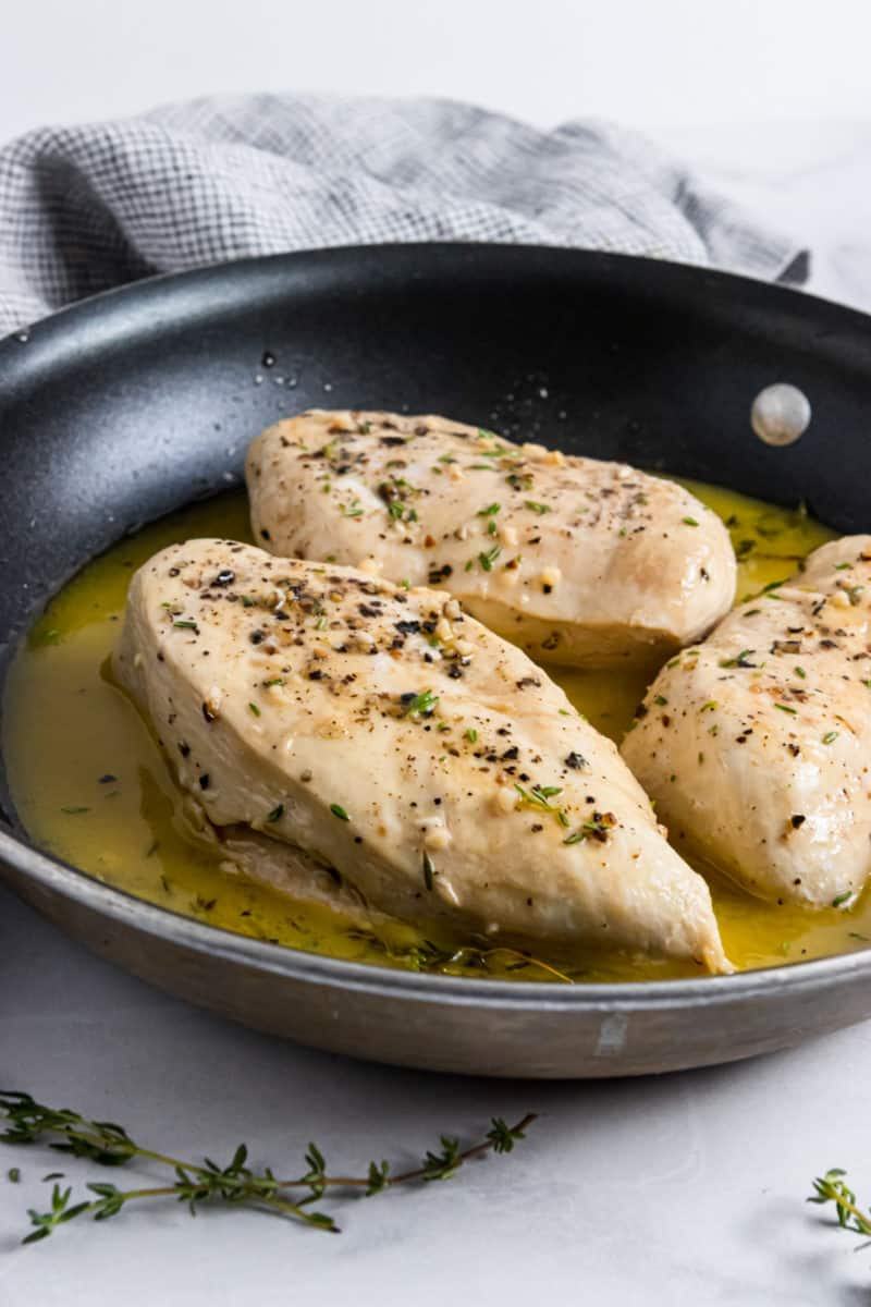 Pan seared chicken in skillet with butter and wine.