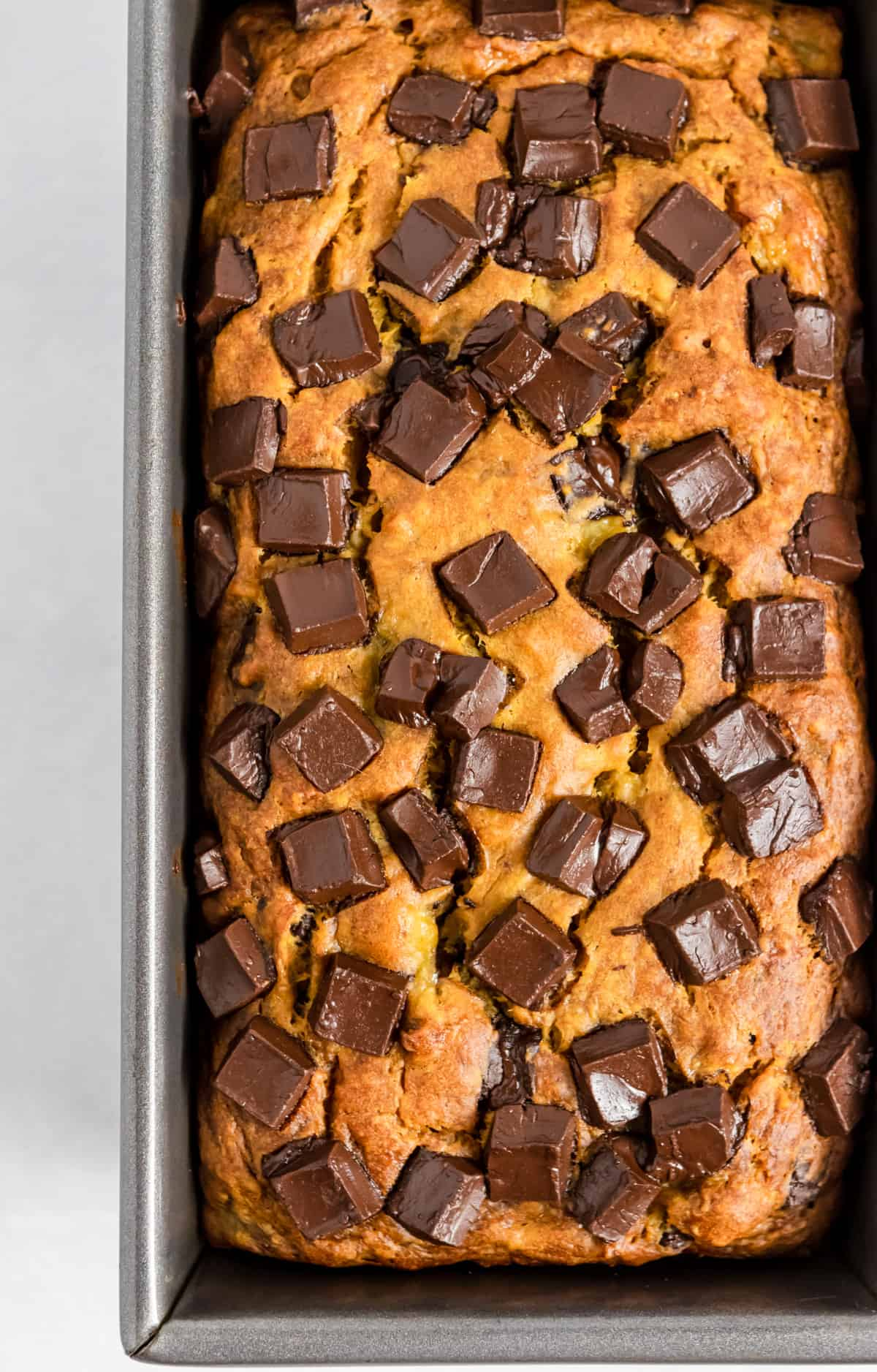 Loaf of banana bread with chocolate chips.