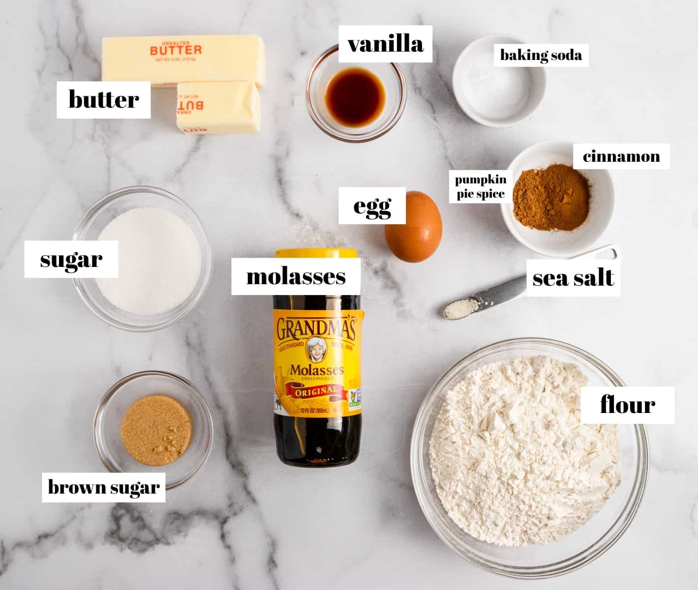 Butter, flour, pumpkin spice, cinnamon, molasses and other ingredients labeled on counter.