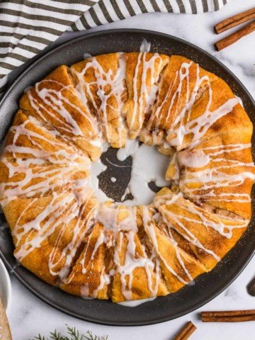 Cinnamon crescent roll wreath with icing drizzle.
