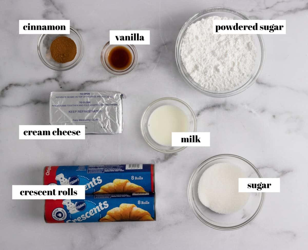 Labeled ingredients on counter: crescents, powdered sugar, cream cheese and more.