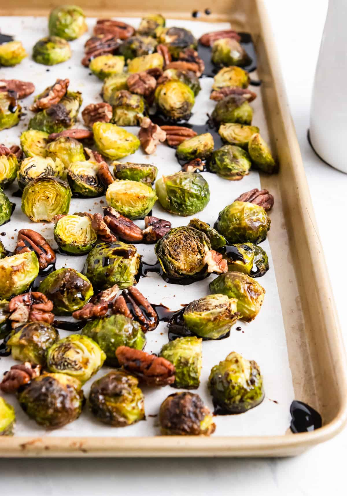Roasted brussels sprouts on pan.