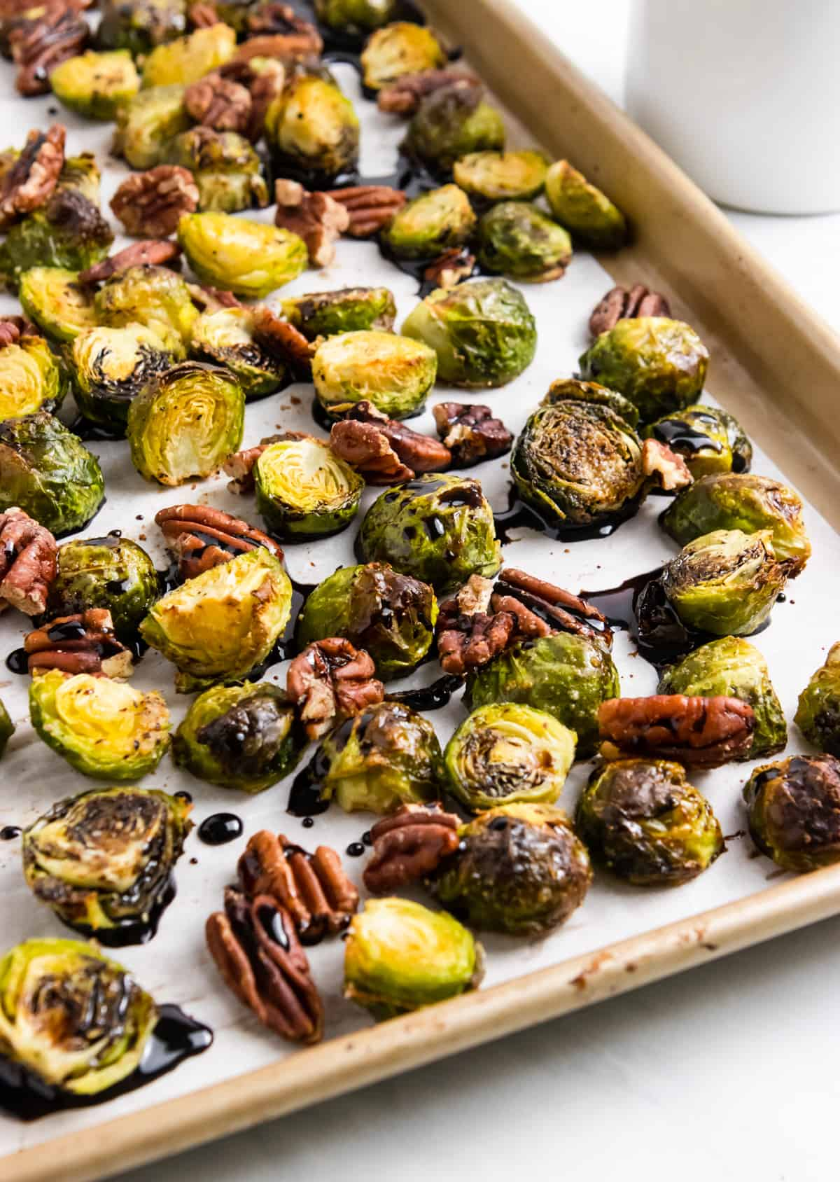 Roasted Brusel Sprouts on pan with pecans.