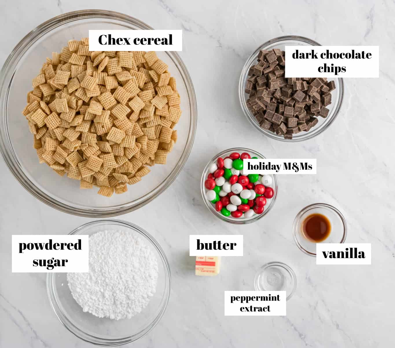 Chex, chocolate, powdered sugar and ingredients labeled on counter.